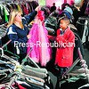 Brittany Tschirhart, 17, of Saranac Lake selects a colorful gown from the costume department of Pendragon Theatre that she hopes will give her a Minnie Mouse look for Halloween. Her brother, Devin Rivers, 11, tries on an oversize sport coat. The theater, located at 148 River St. in Saranac Lake, has more than 2,000 costume pieces that the public can select from and rent for Halloween. A nominal deposit is charged, and costumes must be returned between 1 and 6 p.m. Nov. 2. The theater will be open from noon to 3 p.m. Saturday for costume selection.<br><br>(P-R PHOTO/JACK LaDUKE)