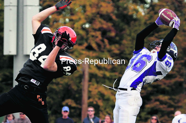 Ticonderoga's Anthony Costello (36) intercepts a pass intended for Plattsburgh's Nate Leopold (84) during Saturday's Champlain Valley Athletic Conference football game. The Sentinels defeated the Hornets, 34-6. <br><br>(P-R Photo/Gabe Dickens)