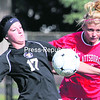 Buffalo State's Meghan Allen (17) stops the ball in front of Plattsburgh State's Macee Maddock during Saturday's SUNY Athletic Conference women's soccer game. The Cardinals and Bengals battled to a scoreless tie.<br><br>(P-R Photo/Gabe Dickens)