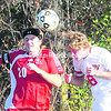 Beekmantown's Zach Brockway (6) heads the ball in front of Saranac Lake's Nick Bayrons (20) during Wednesday's Section VII Class B boys' quarterfinal playoff game. The Eagles defeated the Red Storm, 5-1, and will play Peru in the semifinals. <br><br>(P-R PHOTO/ROB FOUNTAIN)