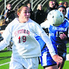 Plattsburgh State's Lauren Gonyea (19) chases down a ball during Friday's SUNY Athletic Conference women's game against Fredonia. The Cardinals fell 3-0.<br><br>(P-R Photo/Rob Fountain)