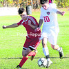 Beekmantown's Alex Price (10) tries to maneuver around Saranac Lake's Jeff Stevens (1) during Section VII Class B boys soccer quarterfinal action in Beekmantown Wednesday. Beekmantown advanced with a 5-1 victory.<br><br>(P-R PHOTO/ROB FOUNTAIN)