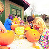 Maggie Carpenter, 11 (from left); Lilie Delancett, 8; Peter Fogarty; master-carving instructor Mark Paul; Mayah Land, 8; and Jessica Vanzile, 12, carve Jack-o'-lanterns at an event sponsored by the Adirondack Carousel in Saranac Lake. The five-week program included more than a dozen children who also learned to carve Ivory Soap figures and snake walking sticks and enjoyed free carousel rides. A gala event from 5 to 7 tonight will display their work, when the Jack-o'-lanterns will be lit up.<br><br>(P-R PHOTO/JACK LaDUKE)