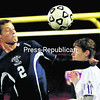 AuSable Valley's Nate Casey (2) and Plattsburgh's Yanis Yahiaoui (15) look to gain control of the ball during Friday's Northern Soccer League boys' contest. The Patriots picked up their first  win in two years with a 2-1 overtime victory.<br><br>(P-R Photo/Rob Fountain)