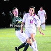 Plattsburgh State's Fabian Chaparro (10) sends in a shot with Clarkson's Ben Morton-Black looking on during Wednesday's men's college soccer game. The Cardinals came away with a   2-0 win.<br><br>(P-R Photo/Rob Fountain)