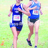 Peru's Ashley Leta (left) and Seton Catholic's Margaret Champagne battle during the girls' portion of the Section VII Invitational at Cadyville Rec. Park. Leta finished first in 19:19, edging Champagne   by a single second.<br><br>(P-R Photos/Rob Fountain)