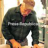 """Lawrence """"Larry"""" Post sands a maple slab in his workshop.<br><br>(Staff Photo/Robin Caudell)"""