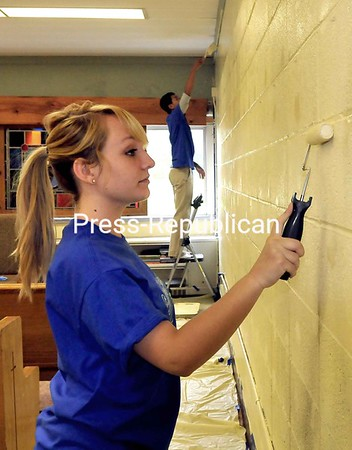Seton Catholic Central School senior Rebecca DuMarsand Vincent Bui lay down a new coat of paint in the school's chapel Friday during their Community Day Service in Plattsburgh. Students also did community service at the Salvation Army, St. Peter's Church, Evergreen Valley Nursing Home and Meadowbrook    Health Care.<br><br>(P-R PHOTO/ROB FOUNTAIN)