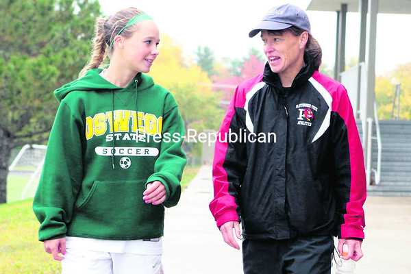 Plattsburgh State coach Karen Waterbury  (right) walks with her daughter Bailey, a freshman at Oswego, after Saturday's SUNY Athletic Conference game.<br><br>(P-R Photo/Gabe Dickens)