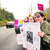 Brenda Dadds-Woodward, 29, of Dannemora, leads a group of protesters in Wilmington along Rte. 86 where biologists and technicians from the Department of Environmental Conservation made the decision to euthanize and remove a moose there this week because of the animal's deteriorating health and public safety concerns. DEC officials said the moose's condition and injured legs made it likely that the animal would have died there as it was unable  to remove itself from the ravine. Dadds-Woodward said she was concerned that the DEC made a hasty decision in how to remove    the moose. Despite rain, about a dozen people showed up at Saturday's protest.<br><br>(P-R PHOTO JACK LaDUKE)