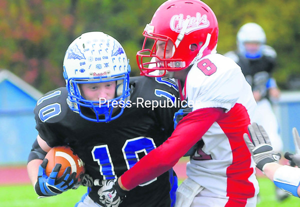 Peru's Tim Remillard (10) looks to shed Saranac defender Lance Hackett (8) during Saturday's Champlain Valley Athletic Conference football game. Remillard finished with 200 yards and three touchdowns in the Indians' 51-0 victory.<br><br>(P-R Photo/Rob Fountain)