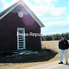 Allen Dixon stands next to the Lyon Street School, a one-room schoolhouse that he sold to the Town of Peru. The building has been has been nominated to the State and National Registers of Historic Places.<br><br>(STAFF PHOTO/KELLI CATANA)