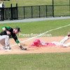 Plattsburgh State's Shane Houppert slides safely into third base as Castleton State third baseman Connor Hoagland is unable to handle the throw during the Cardinals 11-10 victory over the Spartans on Sunday in Plattsburgh. The Cardinals followed that victory with a 5-4 win in the second game of the doubleheader. <br><br>(STAFF PHOTO/KELLI CATANA)