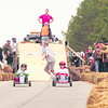 Contestants in the soapbox derby take off out of the gates during Sunday's Daffest festivities in Saranac Lake. The third-annual celebration included a pastry competition, historical tours, pie-eating contest, music and more. Upwards of 500 people gathered to kick off the popular festival.<br><br>(P-R PHOTO/JACK LADUKE)