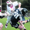 Plattsburgh's Anthony Parfundi (middle) knocks Geneseo's Erik Waltz to the turf Saturday during a SUNYAC lacrosse game at the Field House Complex. The Cardinals won, 14-5.<br><br>(P-R PHOTO/GABE DICKENS)
