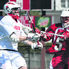 Plattsburgh State's Tom Duggan (left) makes a pass while under pressure by Cortland's Brandon Mulholland during Saturday's SUNYAC lacrosse match. The Cardinals fell, 15-12, to the top-ranked Red Dragons.<br><br>(P-R PHOTO/GABE DICKENS)