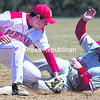 Plattsburgh State's Brian Latulipe can't apply the tag to Cortland's P.J. Rinaldi in time as he slides in safely to second with a stolen base. The Cardinals dropped two 7-0 games to the Red Dragons.<br><br>(P-R PHOTO/GABE DICKENS)
