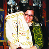 Rabbi Kari Tuling poses with a Torah, which will be read during the Days of Awe at Temple Beth Israel in Plattsburgh.<br><br>(STAFF PHOTO/ROBIN CAUDELL)
