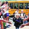 "New Westport Central School kindergartner Brody Pierce puts up a hand for a high-five from a member of the girls soccer team as he and a line of Eaglets arrive at the school for the first of three days of orientation this week. It has become tradition at Westport Central School for the team to take a break from practice and scamper up the hill to the front staircase to greet the children on this day each year. They gave the youngsters high-fives and encouragement, and also melted at the cuteness parading into the school. ""I wish I could just take them home with me,"" one girl exclaimed. School Principal Michele Friedman was there to greet the children as well and offer support to a mother or two.<br><br>(P-R PHOTO/ALVIN REINER)"