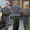 Randy J. Dwyer, 48, is led out of New York State Police barracks in Malone after his processing on drug charges.<br><br>(P-R PHOTO/ALVIN REINER)