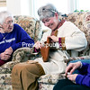 """Retired Plattsburgh High School teacher Anne Bailey (middle), dressed as Sacajawea, shows off her seashell collection to residents Thelma Douglas (left) and Hilda Maston at the Samuel F. Vilas Home in Plattsburgh recently during the weekly Thelma's Corner meeting. Douglas, who has traveled the world, began holding informal meetings based on her adventures after residents heard she had many great stories to tell. Now the group meets every Thursday that features a guest speaker who talks about their travels to a particular country or region, including Nepal, Egypt, Italy, African Safari, etc. Once during a trip to the Virgin Islands, Douglas exchanged 'hellos' with a man she had passed on the beach, and noticed he was wearing a purple shirt with the slogan """"Whatever happens"""" on the front, and """"Don't miss it"""" on the back. Since then, it's become almost a way of life for Douglas. Recently, a relative made a similar shirt for Douglas, and now many of her friends at the home have requested a shirt of their own, which they proudly wear to the weekly get-togethers. If you would like to be a guest speaker on Thelma's Corner, you can contact Thelma Douglas at 563-4960 ext. 314.<br><br>(P-R Photo/Gabe Dickens)"""