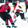 Beekmantown's Josh Barriere (left) defends as Plattsburgh High's Eric Bechard carries the puck down the ice during a CVAC hockey game Dec. 19, 2012. The Eagles and Hornets will meet in the Section VII championship game tonight.<br><br>(P-R Photo/Rob Fountain)