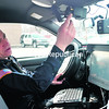 Plattsburgh City Police Department Patrolman Carman Rotella shows the wireless mobile computer system in a police cruiser and the HD camera system that records traffic stops. The department uses funds from grants and asset-seizures to keep current with technology and training, according to Chief Desmond Racicot.<br><br>(STAFF PHOTO/KELLI CATANA)
