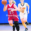 Moriah's Lauren Pelkey (left) dribbles the ball up court as Indian Lake/Long Lake's Jessica Bain trails the play during Tuesday's Section VII Class D girls' basketball semifinals. The Vikings advanced to the final.<br><br>(P-R Photo/Gabe Dickens)