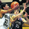 Chazy's Keenan Hampton (23) goes in for a layup as Westport's Thomas Mero (33) tries for the block during Wednesday's Mountain & Valley Athletic Conference boys' basketball game. Westport captured a 55-47 victory.<br><br>(P-R Photo/Rob Fountain)
