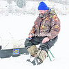 Port Henry resident Jan Morin sits at his ice fishing spot on Lake Champlain near Port Henry waiting for a bite. Morin was fishing in Bulwagga Bay, a favorite location for ice anglers.<br><br>(P-R PHOTO/LOHR McKINSTRY)