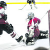 Beekmantown's Kallie Villemaire (13) sneaks a goal past Saranac Lake's goalkeeper Katey Snyder (30) duringWednesday's Upstate Girls' Hockey League playoff opener. The Eagles advanced with a 5-1 victory. <br><br>(P-R PHOTO/ROB FOUNTAIN)