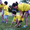 Jack LaBombard (kneeling), 7, of Plattsburgh positions himself with a little help from volunteer Kristen Lukas before taking off in a track-and-field event during the MVP Kids sporting league for ages 5 through 8 at the U.S. Oval Tuesday afternoon. Created by Katie Bond nearly four years ago, the program is a non-competitive league with a focus on building social skills, teamwork and athletic ability for children with autism spectrum disorders. The group is currently working to obtain their nonprofit designation. <br><br>(P-R PHOTO/GABE DICKENS)