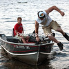 """Brett Carnright (left) brings his 16-foot aluminum fishing boat just close enough for his friend Cole Carter to jump ashore from Lake Champlain along Blair Road on Cumberland Head in Plattsburgh on a recent summer evening. The friends spent two hours on the lake testing Carnright's new toy """" a Lowrance HDS-10 fishfinder """" allowing him to accurately map the structure of the lake bottom to determine the location of fish. The new equipment will be put to good use, as Carnright estimates he fishes about 100 days out of the year.<br><br>(P-R PHOTO/GABE DICKENS)"""