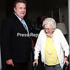 Scott Hurlburt (left), administrator of the Vilas Home in Plattsburgh, escorts resident Ruth Hagen, who has been living at the home for nearly eight years, out of one of the sunrooms. The senior citizens home will be celebrating its 125th anniversary with an open house with various activities Saturday morning.<br><br>(P-R PHOTO/GABE DICKENS)