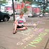 Kim Cummins works on some sidewalk messages that she and other members of Reality Check hope will spread the word about the importance of reducing tobacco advertising in stores where teens and children purchase other products.<br><br>(P-R Photo/Jeff Meyers)