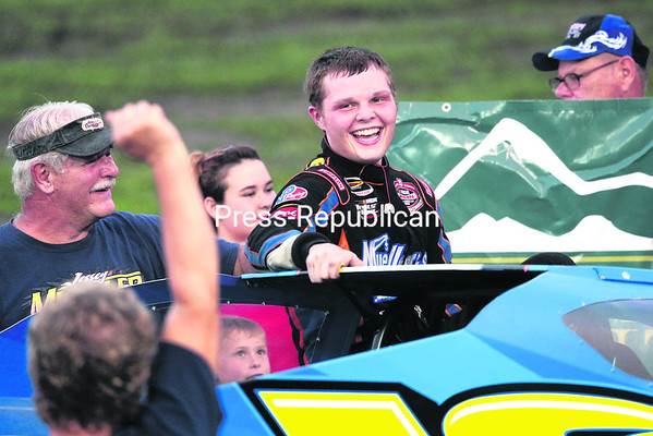Jessey Mueller is all smiles after taking the checkered flag after several restarts in the 30-lap modified feature at Airborne Speedway in Plattsburgh Wednesday evening. (PR Photo/Gabe Dickens)