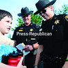 Clinton County Sergeant William Dominy (middle) and Deputy Kristen Brassard (right) present 8-year-old Seth LaBarge with a Certificate of Bravery for his actions when his younger brother, Kaleb, got too close to a candle and caught his clothes on fire at their Beekmantown home.<br><br>(P-R PHOTO/GABE DICKENS)