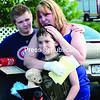Josh Clark (from left), 13, Seth LaBarge, 8, and their mother, Kayla Jackson, share a moment at their Beekmantown home Wednesday afternoon after they were visited by several local firefighters, EMS personnel and the Clinton County Sheriff's Department to honor LaBarge for saving his younger brother's life two weeks ago.<br><br>(P-R PHOTO/GABE DICKENS)