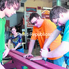 CV-TEC students Alex Parrow (from left), Brianna Rotella, Kyle Winter and Ian Winner assemble a picnic table, one of six built by instructor Mike Drew's building-trades classes for the Plattsburgh Housing Authority. Both the morning and afternoon classes on the Plattsburgh campus were split into three teams that each chose a foreman, planned a schedule and kept daily work records throughout the project.<br><br>(P-R PHOTO/GABE DICKENS)