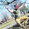 Keagan French, 21, president of the new Platty Slack Club at Plattsburgh State, demonstrates slacking, a technique in which people balance and jump on a piece of 2-inch webbing. Slacking is similar to tightrope walking except it's low to the ground. French said it's a good workout for the whole body and that, as with yoga, you must be focused. The club meets once a week on campus, but anyone in the community may attend. To learn more, email French at kfren003@plattsburgh.edu.<br><br>(STAFF PHOTO/KELLI CATANA)