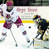 Plattsburgh State's Teal Gove takes a shot on Neumann goaltender Shannon Donnelly during Saturday's ECAC West semifinal at Stafford Arena. Gove scored 3 goals in 5-0 victory.<br><br>(P-R Photo/Gabe Dickens)