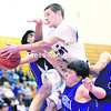 Ausable Valley's Nate Casey gets mixed up with Ticonderoga's Zeshan Afzal (left to right), Karney Manning and Jordan Fuller as he goes for the layup during Saturday's Section VII Class C championship boys' basketball game.<br><br>(P-R Photo/Gabe Dickens)