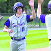 Ticonderoga's Michael Graney (right) greets teammate Ty Denno after he scored on a wild pitch during Tuesday's Class C boys' baseball championship game against Northern Adirondack at Chip Cummings Field. The Sentinels captured the Section VII title with an 18-1 win.<br><br>(P-R Photo/Gabe Dickens)