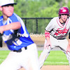 Beekmantown's Justin Stevens (right) takes a lead off first base as Peru's Andy Kneussle winds up to deliver a pitch during Thursday's Class B boys' baseball championship game at Chip Cummings Field. The Eagles won in walk-off fashion, 5-4.<br><br>(P-R PHOTO/GABE DICKENS)