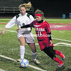 Saranac's Ellen Thew (11)  takes the ball past Marcellus' Shannon Donahue (6) during Saturday's NYSPHSAA Class B regional championship game at Bodley High School. The Chiefs fell to the Mustangs, 7-2.<br><br>(Staff Photo/Courtney Lewis)