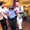 """From right, Casey Cleverly as Fran Ascot; Michael Rehse playing Hubert Jones; Joan Sterling, the American Cancer Society's representative for Clinton and Essex counties; and Director Robert A.K. Gonyo  perform in the murder mystery """"Curse of the Golden Asp"""" at the Elks Lodge in Plattsburgh Friday evening. The dinner event, sponsored by Woodmen of the World Chapters 462 and 1016, was put on by Co-Op Theatre East. All funds raised benefit the American Cancer Society.<br><br>(P-R PHOTO/GABE DICKENS)"""