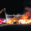 Flames and smoke billow into the air as 23 area fire departments battle the blaze that broke out at Schluter Systems L.P. in the Town of Plattsburgh Saturday.<br><br>(P-R PHOTOS/GABE DICKENS)