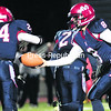 Moriah quarterback Cole Gaddor hands the ball off to CJ Raymond for a carry during Friday's NYSPHSAA Class D regional semifinal football game against Tupper Lake at AuSable Valley Central School. The Vikings won, 29-14.<br><br>(P-R PHOTO/GABE DICKENS)