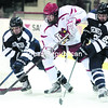 Plattsburgh State's Dakota Mason (middle) carries the puck in the offensive zone while being pressured by Geneseo's Nate Brown (left) and Matthew Hutchinson during Friday's SUNY Athletic Conference men's hockey game at the Field House. The Cardinals defeated the Knights, 4-1.<br><br>(P-R PHOTO/GABE DICKENS)
