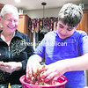 Carol Hofmaister and her grandson Benjamin Field make latkes on the first day of Hanukkah.<br><br>(P-R PHOTO/GABE DICKENS)